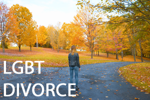A women walking on a path in an autumnal park. With LGBT divorce written in white text in the lower left corner.
