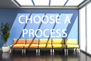 A row of yellow chairs in a blue room with a potted tree on the left. With choose a process written above it in white text